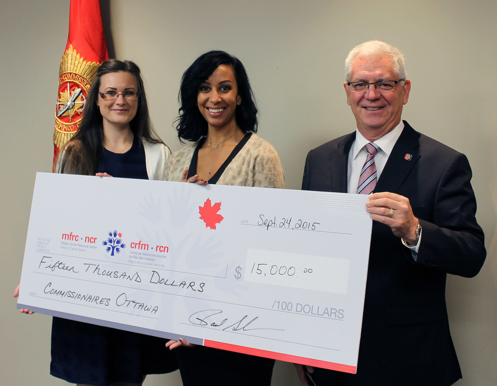 In September 2015, a $15,000 donation was presented by Commissionaires Ottawa to the Military Family Resource Centre – National Capital Region (MFRC – NCR). LtoR Byrnne Doxsee, Executive Assistant, MFRC – NCR, Francesca D'Ambrosio, Partnerships & Major Gifts, MFRC – NCR and Paul Guindon, CEO, Commissionaires Ottawa.